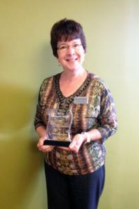 Colette Kroeten holding award